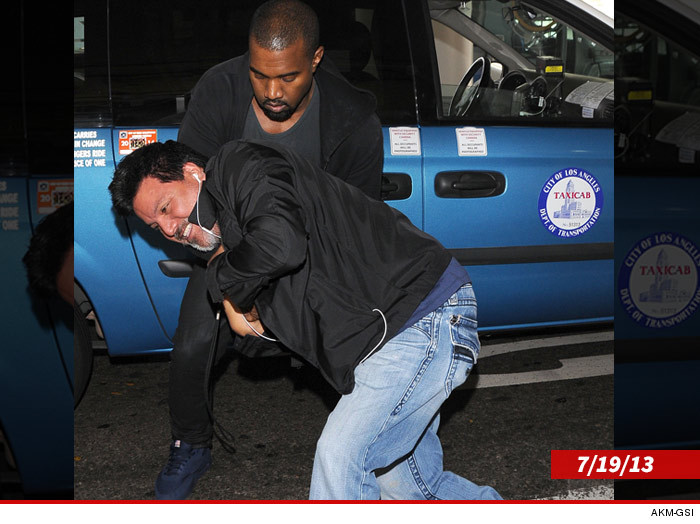 0805-kanye-west-attacks-photog-akm-gsi-3