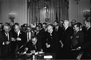 Lyndon_Johnson_signing_Civil_Rights_Act,_July_2,_1964 Cecil Stoughton, White House Press Office (WHPO)
