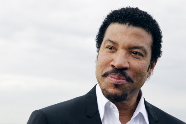 US singer Lionel Richie poses in front o