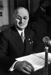Port of Harry Truman at desk w loose leaf notebook