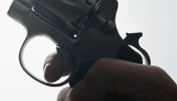 Hand holding gun, close-up