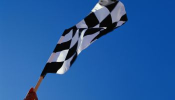 Person Holding Checkered Flag