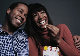 Laughing Couple Watching Movie