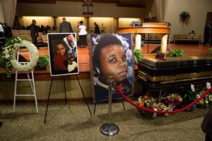 ST. LOUIS, MO - AUGUST 25:  Photos surround the casket of Michael Brown inside Friendly Temple Missionary Baptist Church awaiting the start of his funeral on August 25, 2014 in St. Louis Missouri. Michael Brown,18 year-old unarmed teenager, was shot and killed by a  Ferguson Police Officer Darren Wilson in the nearby town of Ferguson, Missouri on August 9. His death caused several days of violent protests along with rioting and looting in Ferguson.  (Photo by Richard Perry-Pool/Getty Images)