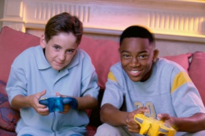 Portrait of two teenage boys playing video games