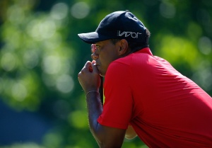 GREENSBORO, NC - AUGUST 23:  Tiger Woods lines up his birdie putt on the 13th green during the final round of the Wyndham Championship at Sedgefield Country Club on August 23, 2015 in Greensboro, North Carolina.  (Photo by Kevin C. Cox/Getty Images)