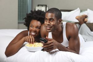 African American Couple Watching a Movie at Home