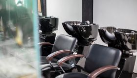 Empty chairs and basins in barbershop