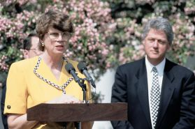 Janet Reno Speaking from a Podium