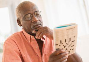 Black man doing crossword puzzle