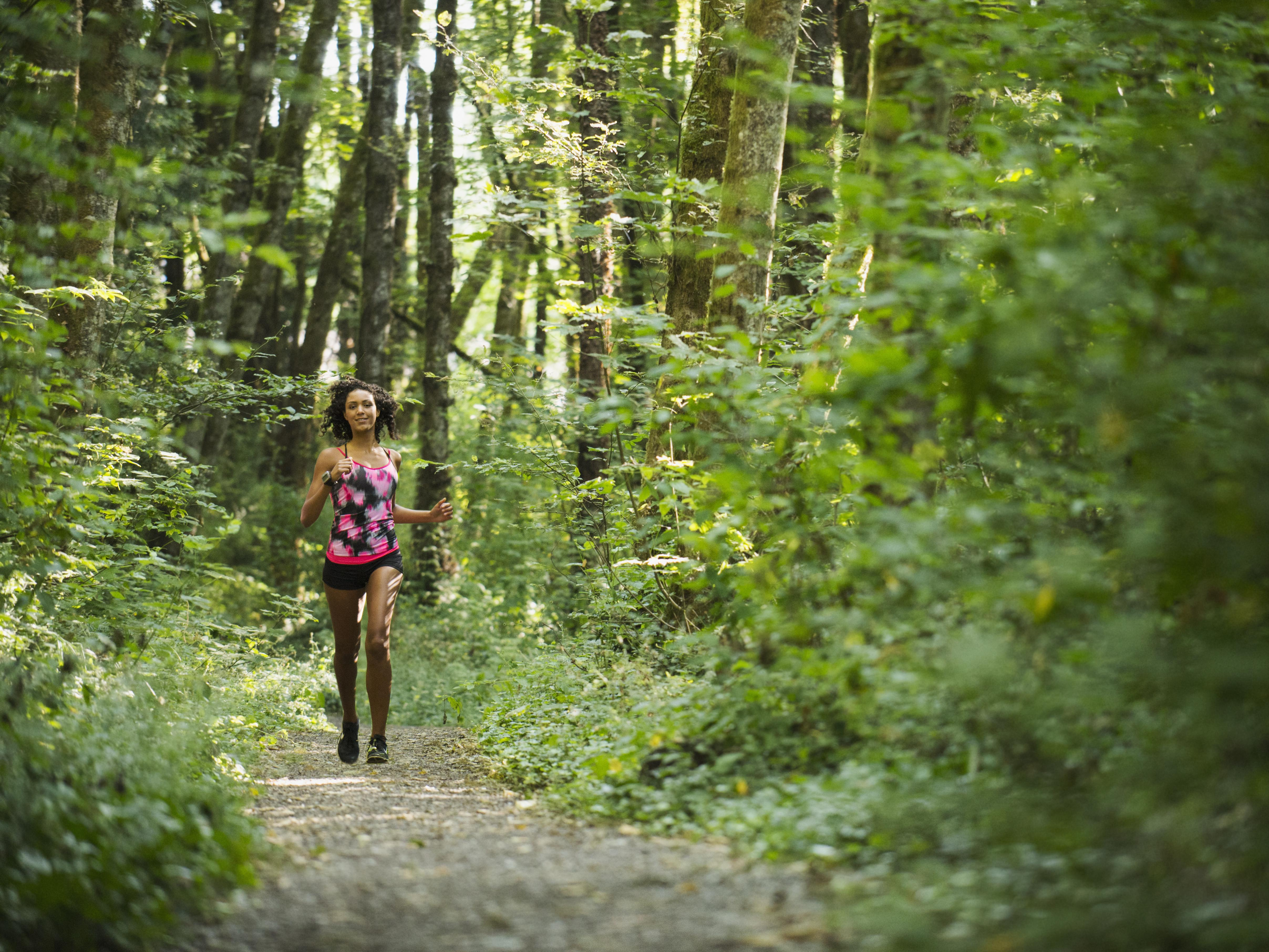 USA, Oregon, Portland, Young women jogging in forest