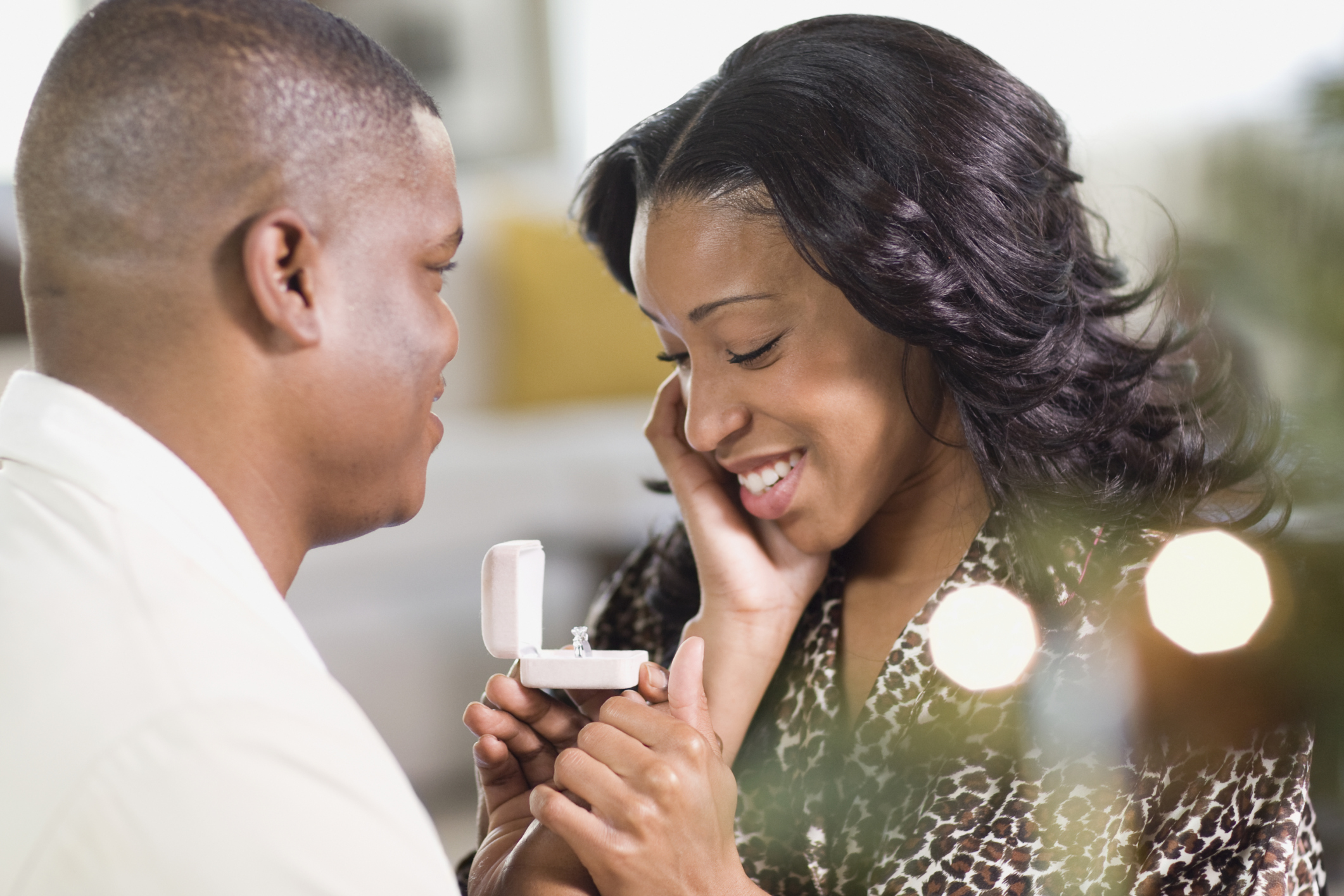 African man giving girlfriend engagement ring