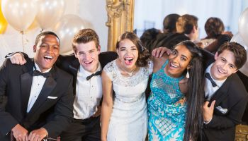 Teenagers and young adults in formalwear at party