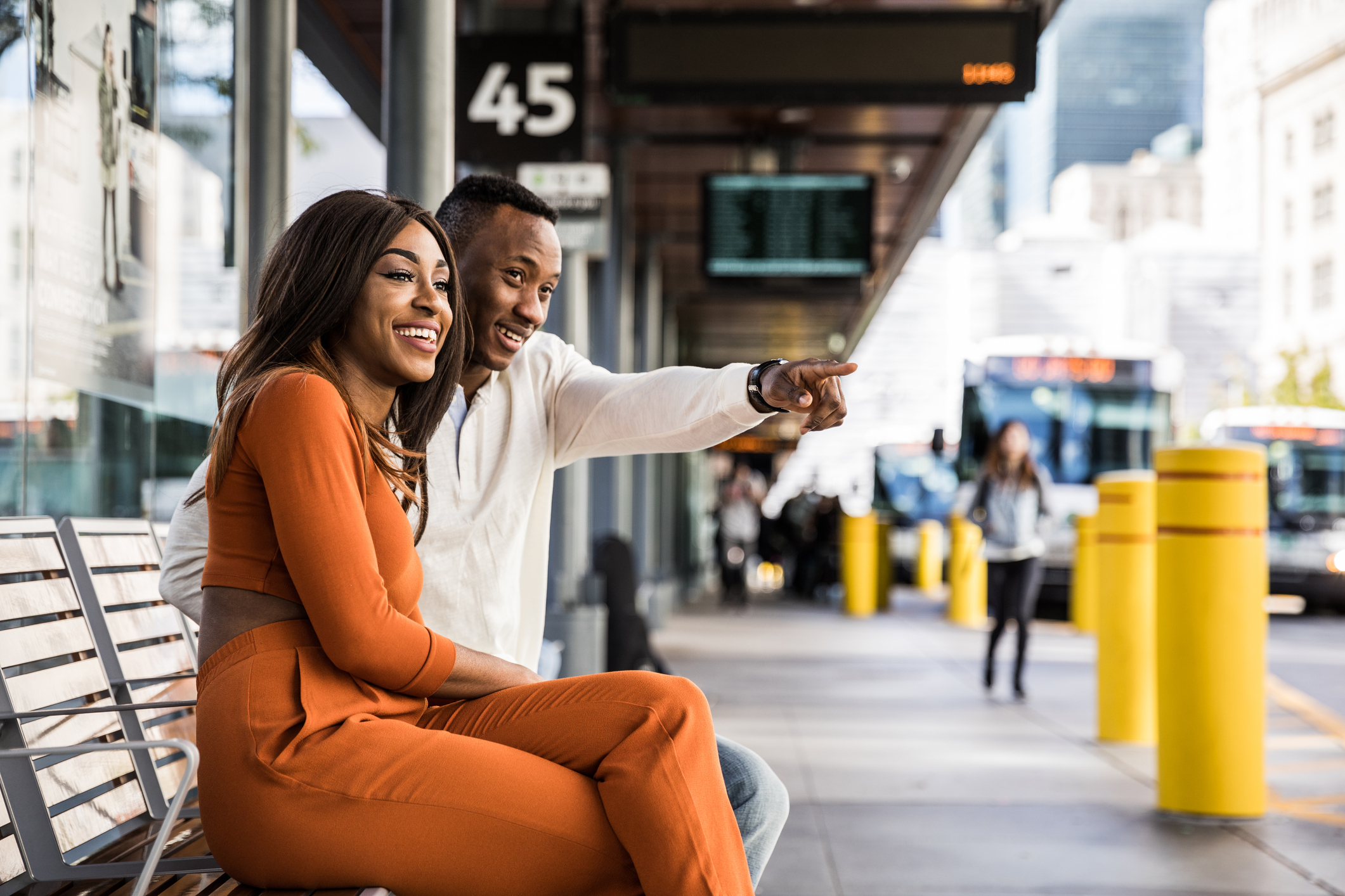 Couple waiting for the bus in Toronto