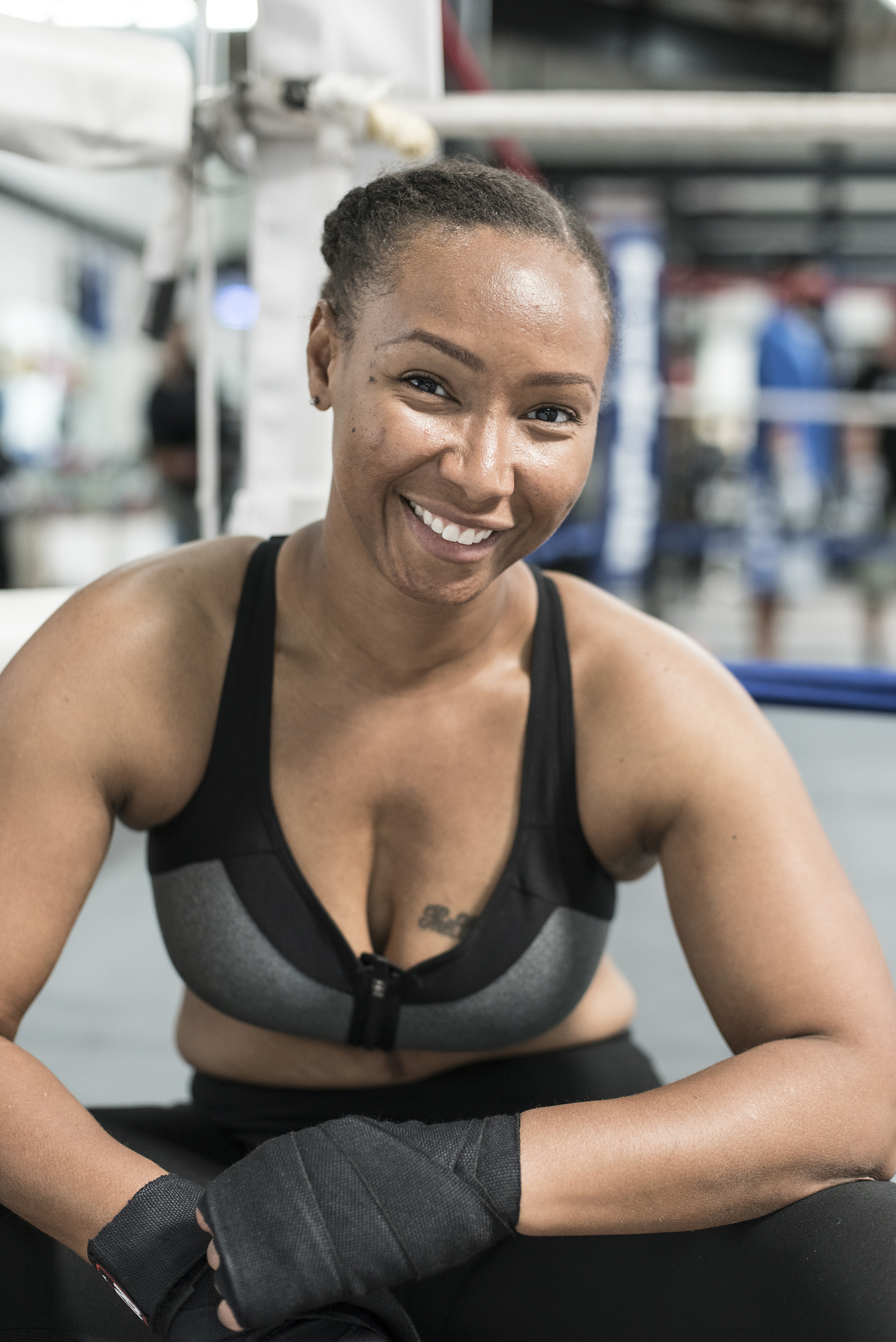 Black woman with wrapped hands in gymnasium