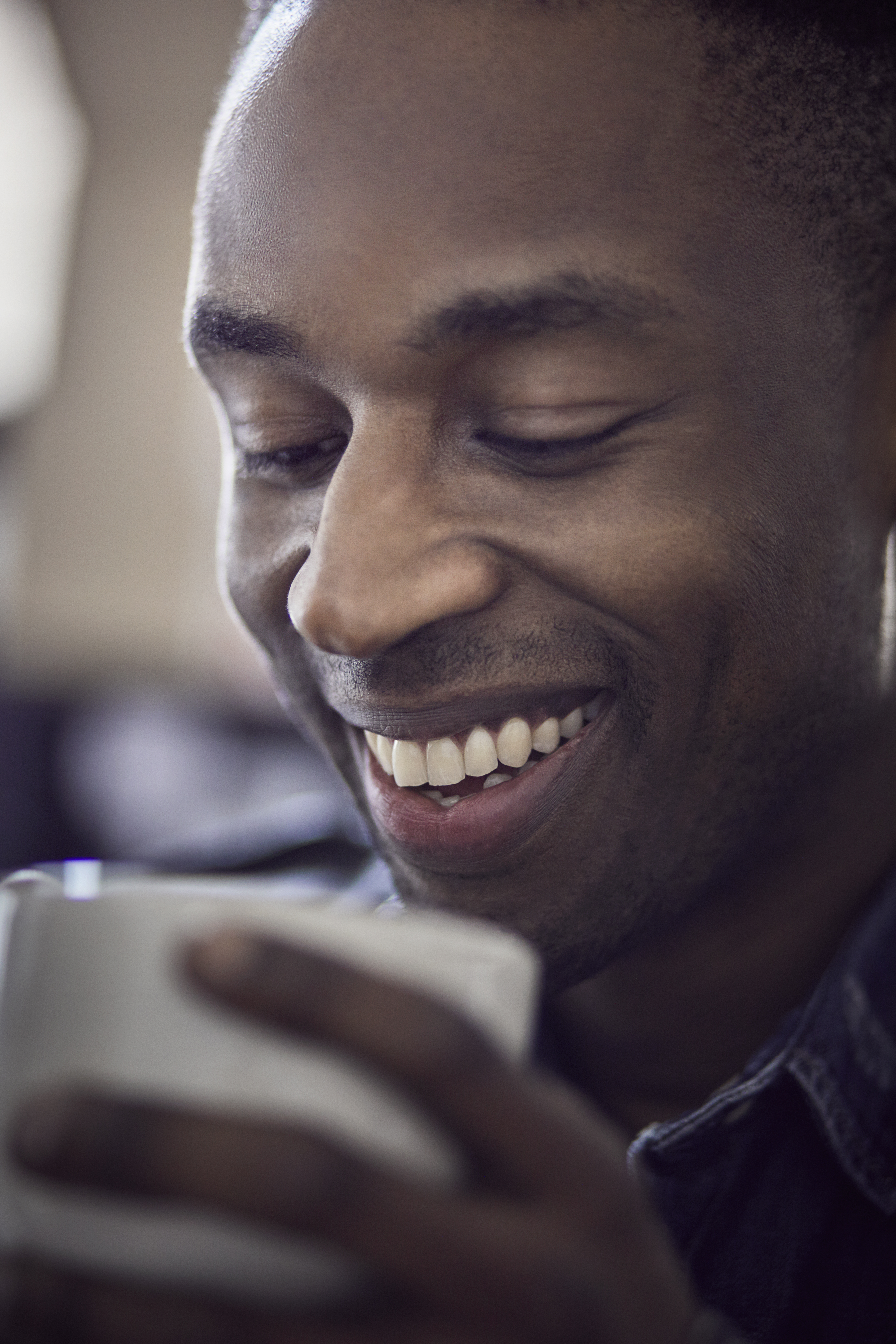 close-up portrait of a man with a coffee cup