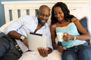 Modern African Couple Looking at Digital Tablet