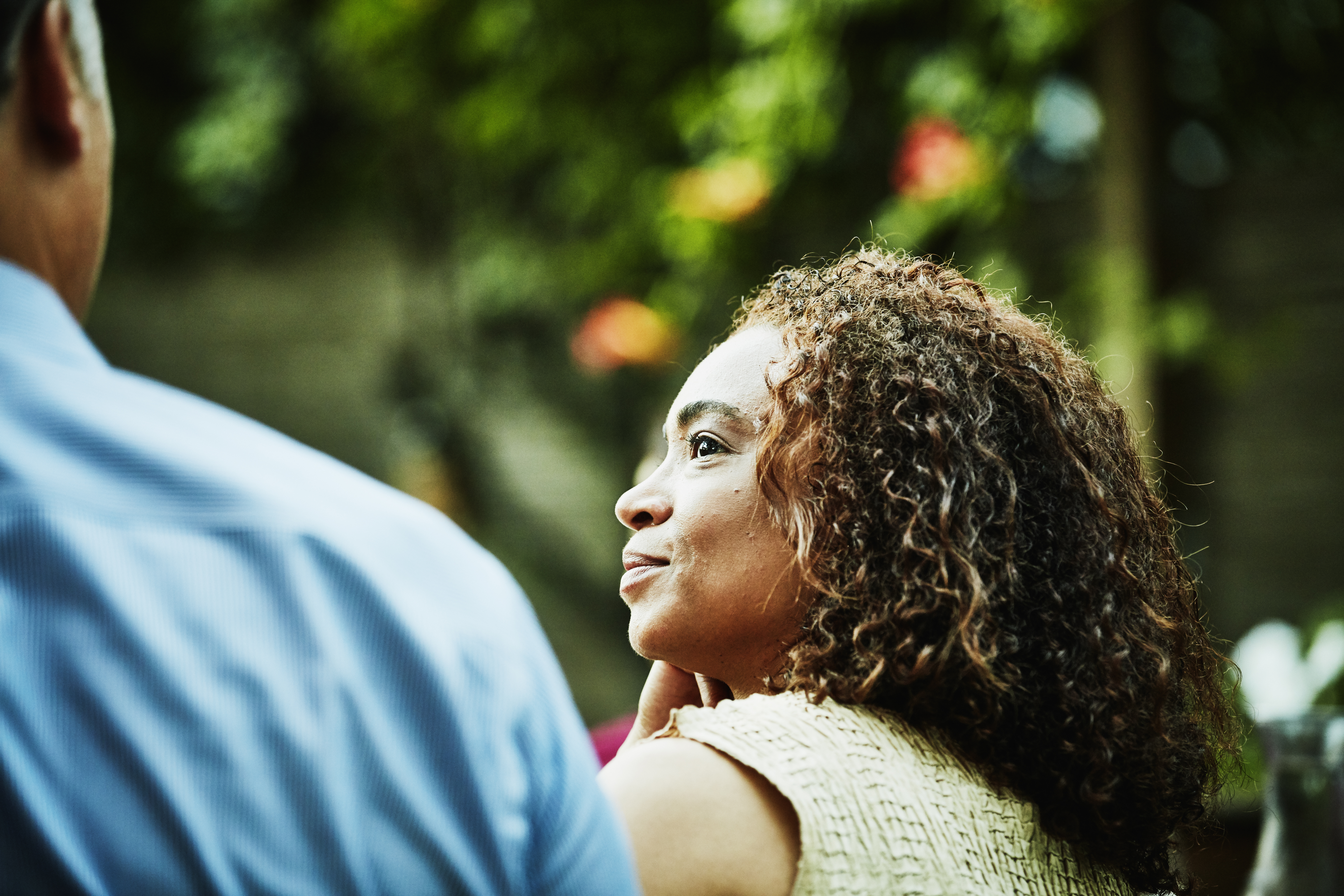 Smiling woman looking at husband during outdoor dinner party