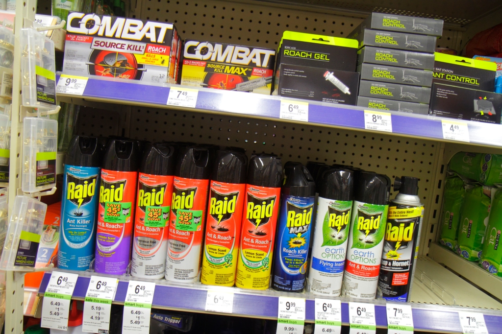 Shelves of bug spray for sale at Walgreens pharmacy.