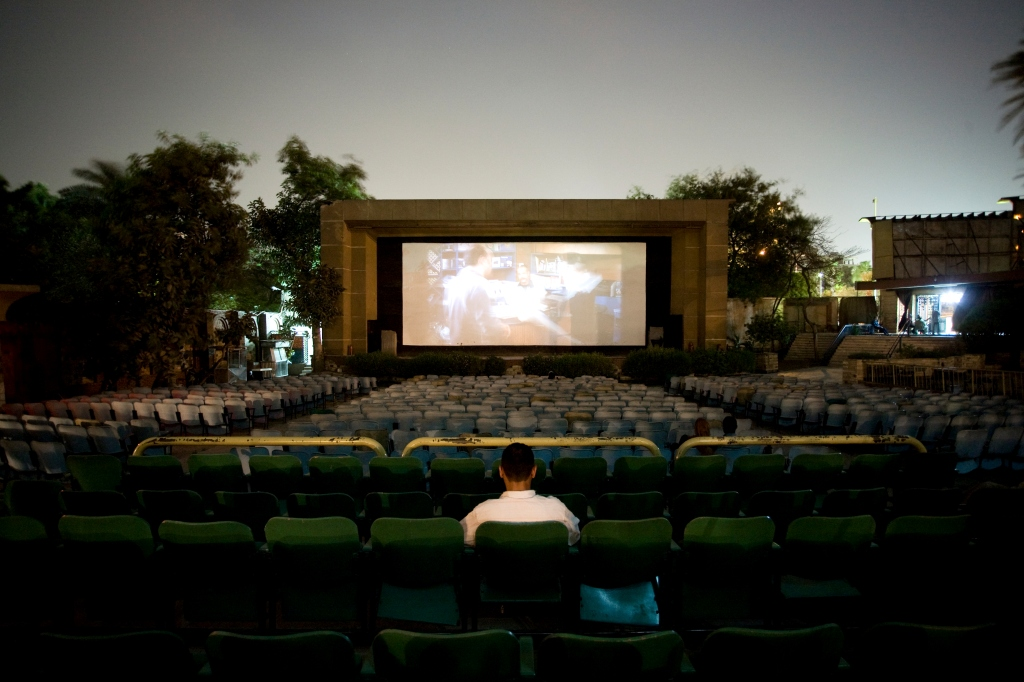 Only one customer can be found in the outdoor cinema El Rubos, Giza whilst watching the recent action film Kaos. Cinema audiences are still strong in Egypt but many prefer to use the new cinema multiplexes or larger indoor cinemas