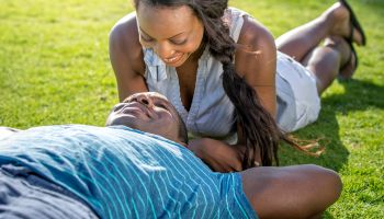 Happy Couple Lying on the Grass