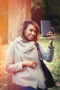 Woman taking selfie in the park