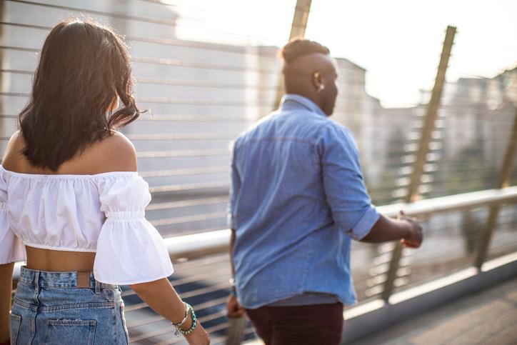 Interracial couple walking in Milan