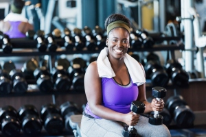 Young African-American woman working out at the gym