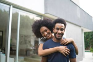 Portrait of a african ethnicity couple smiling outdoors