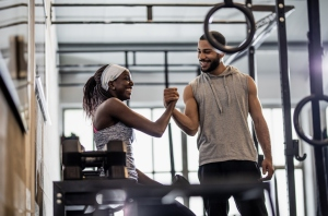Woman Training Weight Lifting With an Instructor