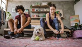 Young multi-ethnic couple preparing for jogging
