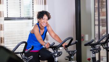 Mature African-American woman on exercise bike