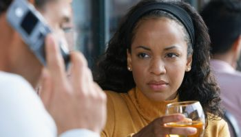 Woman Looking at Man Talk on Cellular Phone