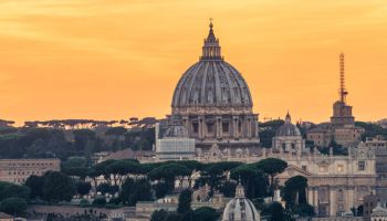 St Peters Basilica and skyline with church cupolas, Vatican, Rome, Italy (Sunset)