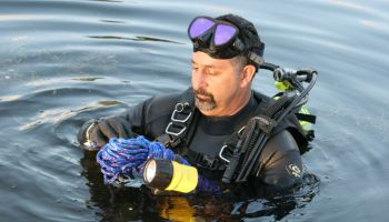 A policeman part of the police dive team in Snake Creek Canal.
