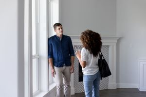 Attentive young man talks with wife in new home