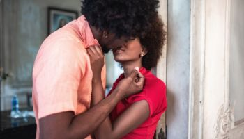 beautiful afro-caribbean couple kissing in old house in Havana