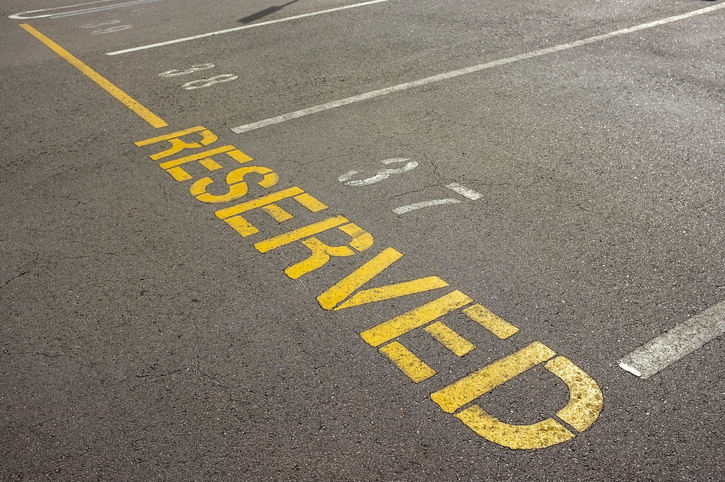 High Angle View Of Sign In Parking Lot