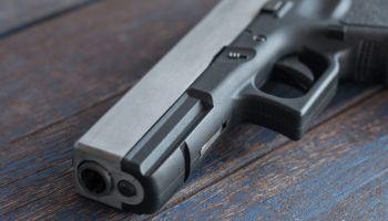 High Angle View Of Gun On Table