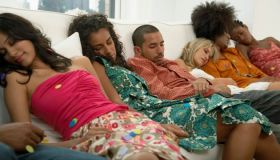 People sleep on couch at party
