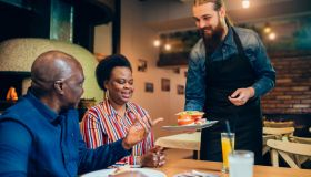 Mature African - American couple enjoying at the restaurant