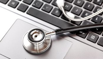 Close up of stethoscope on laptop