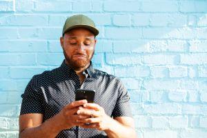Man reacting to smart phone