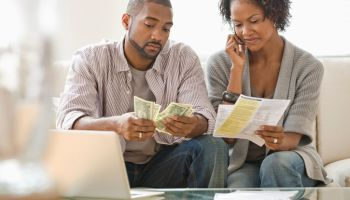 Black couple paying bills