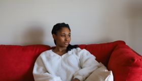Portrait Of Young Woman Sitting On Sofa