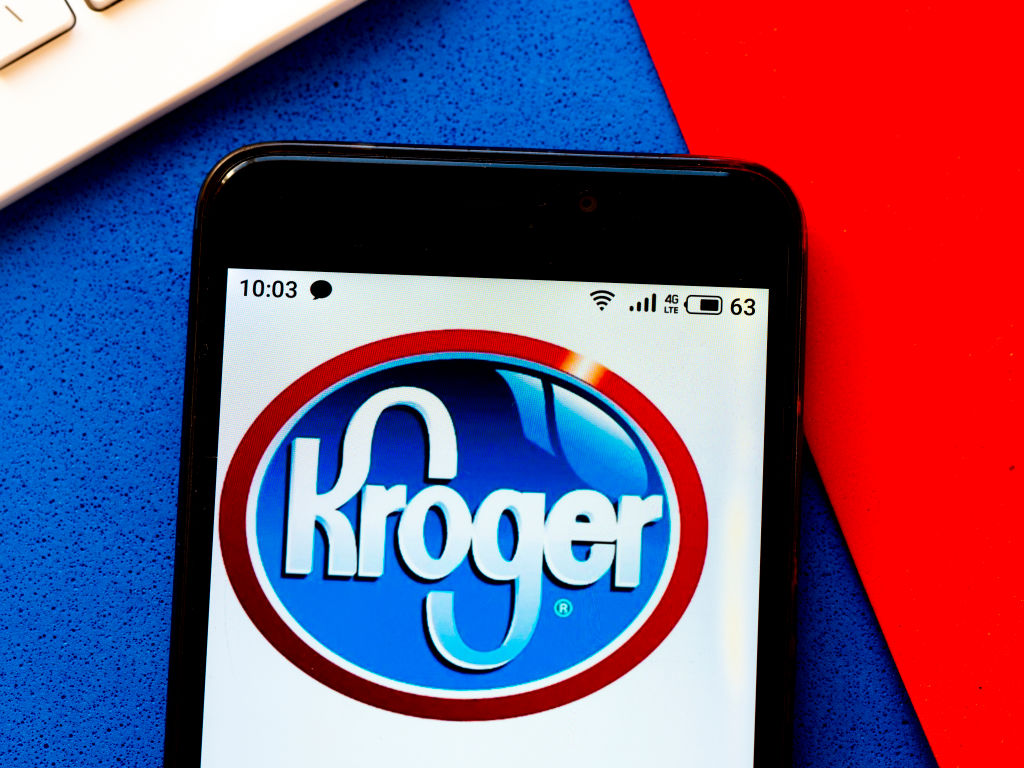 In this photo illustration a Kroger logo seen displayed on a...
