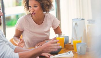 Couple fighting at the breakfast table.