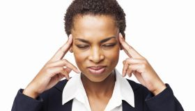 African American Businesswoman With a Severe Headache - Isolated