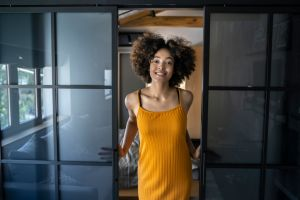 Smiling afro American young woman in modern home