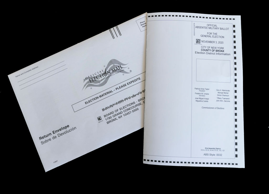 In this photo illustration an absentee mail-in ballot for...